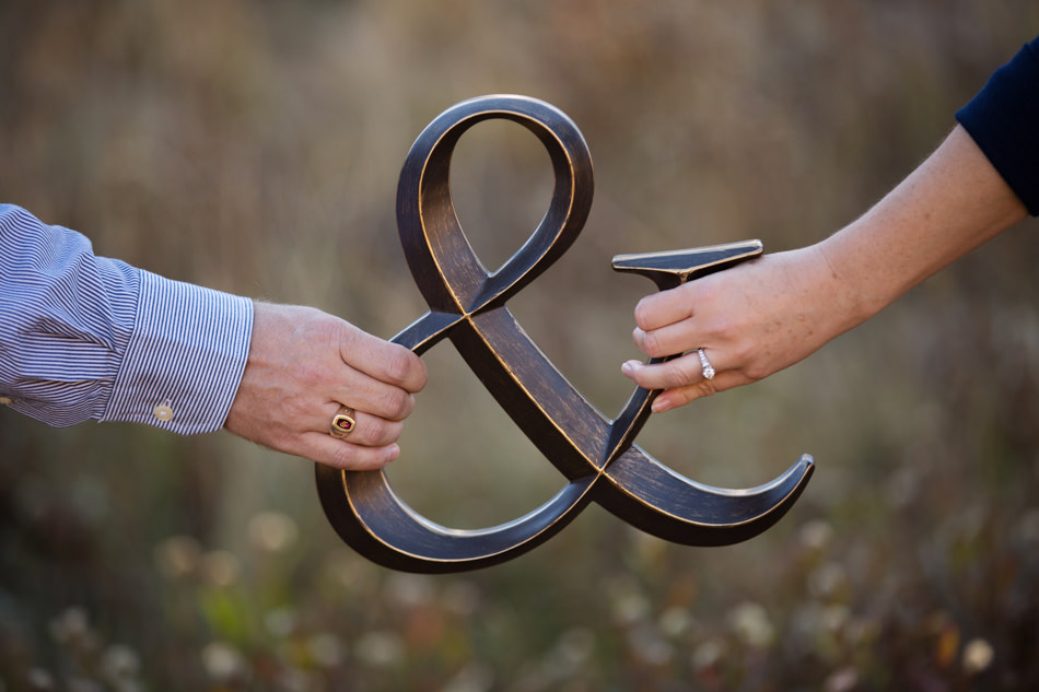 couple holding and sign