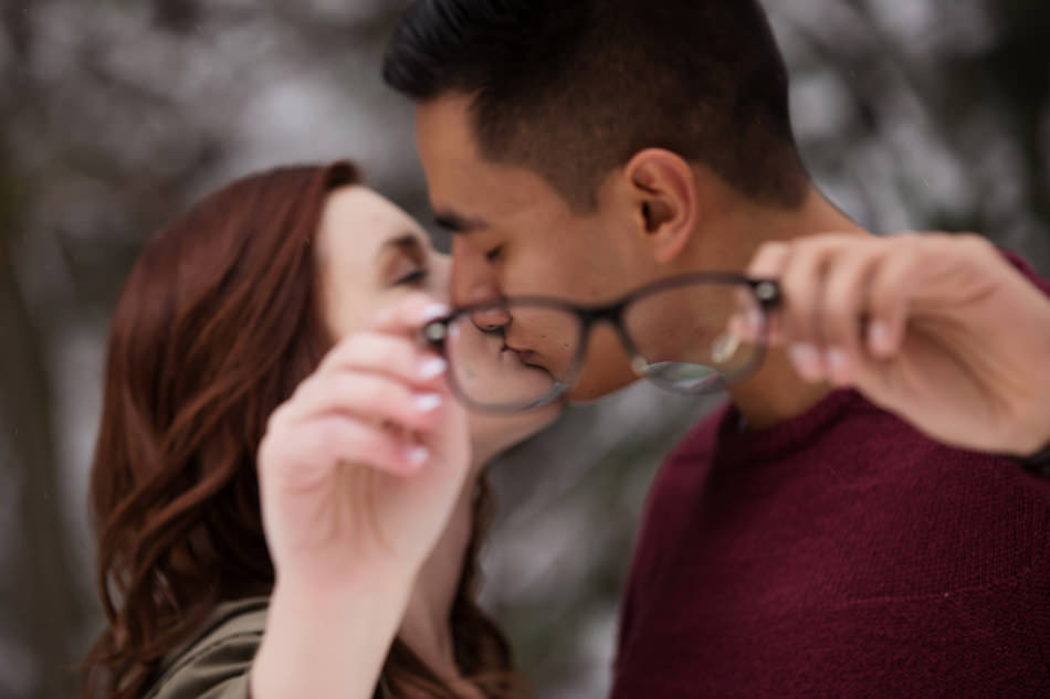 kissing through glasses